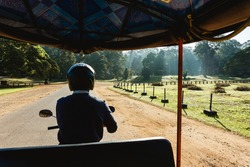 Angkor Wat Tuk Tuk ride - Small circuit tour. Sightseeing with a guide on a motorbike. Morning sunrise temple watching and driving all around. Siem Reap Cambodia vacations attractions.