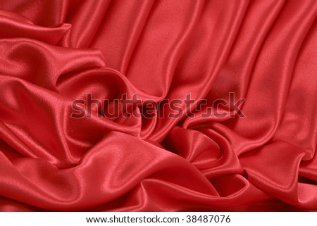 Angle artistic folds of red satin background; close up