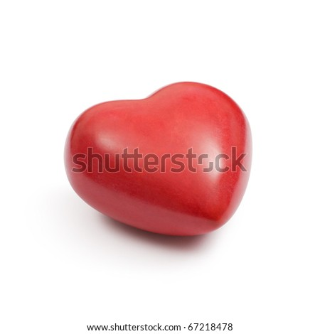 Angle photo of a heart-shaped red stone on a white background.  Clipping path included. - stock photo