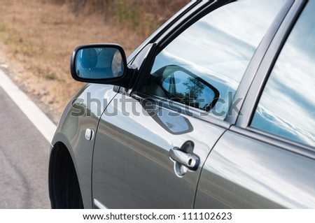 Angle shot of a car with reflection