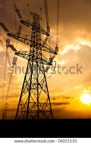 Angle shot of power lines against sunset in the background