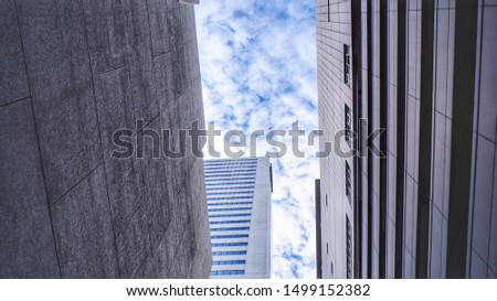 Angle shot upward of the indigo blue sky flanked by left and right tall buildings. Presenting all-round beauty in different angles.
