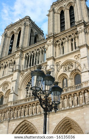 Angled detailed shot of Notre Dame Cathedral, Paris France with street lamp in foreground.