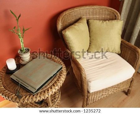 Angled look at table and arm chair