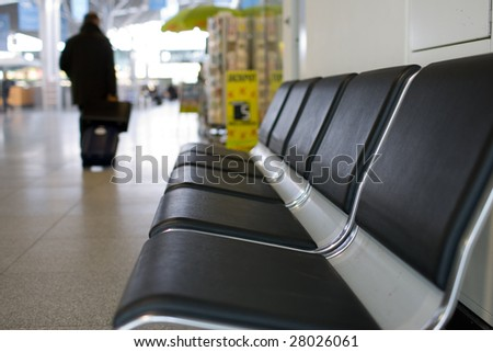 Angled view of a row of airport seats. - Shutterstock ID 28026061