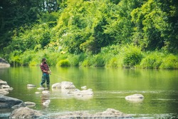 Angler catching the fish. Hobby of real man. Gone fishing. Happy fly fishing. Fisher fishing equipment. Rural getaway. Giving your hobby. Hunting. Trout bait. Luxury life concept