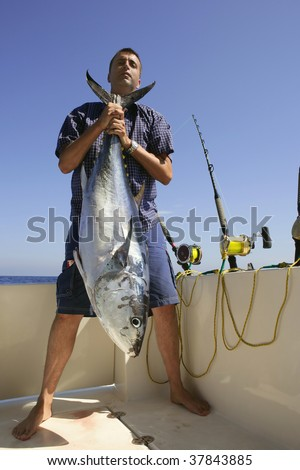 Angler fishing big game bluefin tuna on Mediterranean saltwater - stock photo