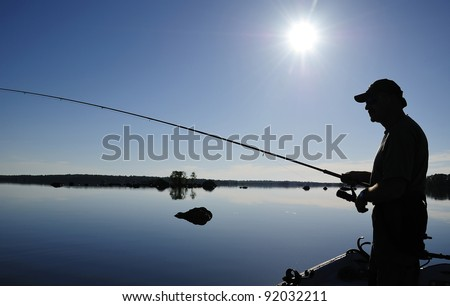 Angler's shadow in morning sun