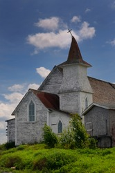 Anglican Christ Church with bent steeple and cross at Clarke's Head Gander Bay Newfoundland