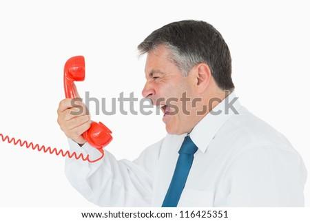 Angru businessman yelling at red phone