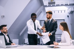 angry african businessman points finger at document boss scolds employee for poor performance, workplace conflict, unpleasant behavior in office