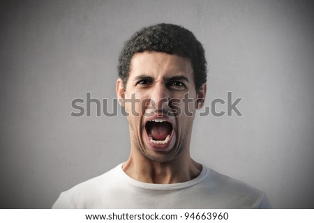 Angry african man screaming
