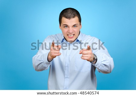Angry aiming businessman on blue background