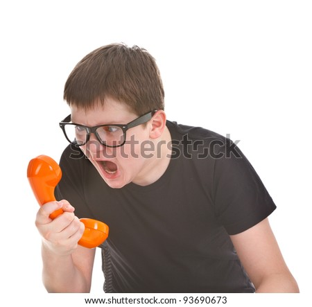 angry and kid screams into the telephone receiver on white background