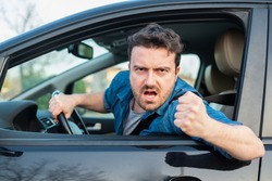 Angry and rude man driving road rage