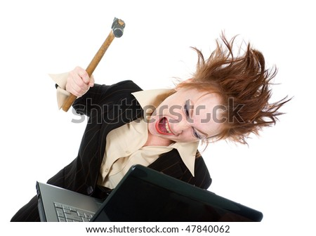 angry and stressed businesswoman smashing her laptop with a hammer