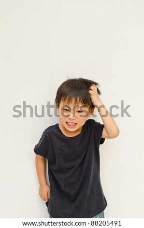 angry asian boy on white background - stock photo