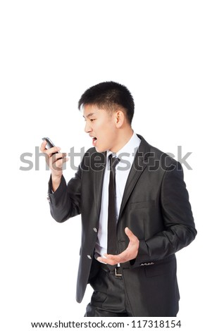 Angry asian business man screaming on cell mobile phone, portrait of young handsome businessman isolated over white background, concept of executive yelling, conversation problem communication crisis