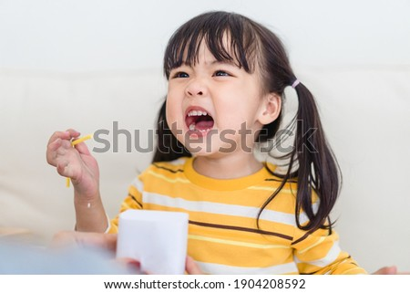Angry asian kid.Little asian girl looking at her mother and fighting with her mom.Furious hungry toddler kid got upset and sad.Stubborn child bad attitude.Depressed little girl complaining with mom.