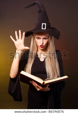 angry  blond witch with a book conjuring, against black and yellow background