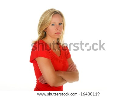 Angry Blond woman with her arms crossed. Portion of photographers commission of this image will be donated to Autism Ontario.