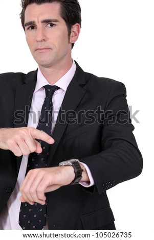 Angry boss pointing at watch