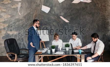 Angry boss reprimanding employee for bad work result sitting at conference table, male ceo scolding incompetent manager blaming for mistake in financial report or failure at team group meeting Photo stock ©