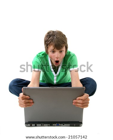 Angry boy looking at laptop computer