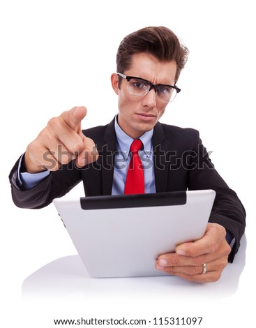 angry business man accusing you while reading on his tablet pad at his desk