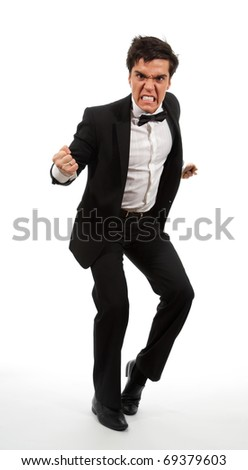 Angry business man in rage holding his fists, isolated on white