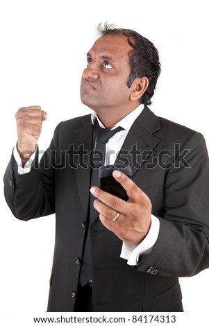 Angry business man with mobile phone
