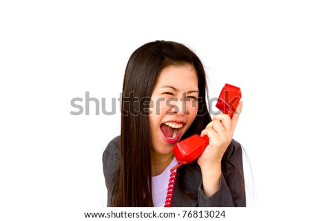Angry business woman screaming in her phone - stock photo