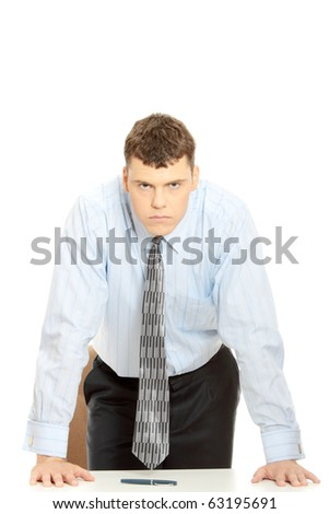 Angry businessman behind the desk