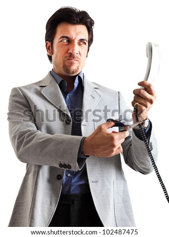 Angry businessman cutting phone cable isolated on white