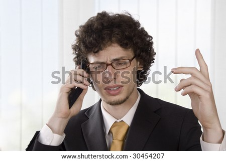 Angry businessman explains in the phone
