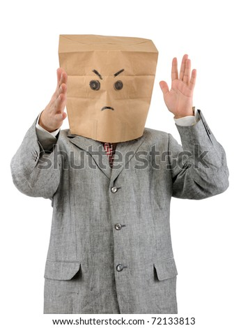 Angry businessman in paper bag on head isolated on white background.