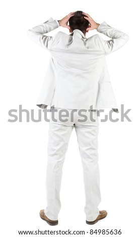 angry businessman. Rear view. isolated over white.