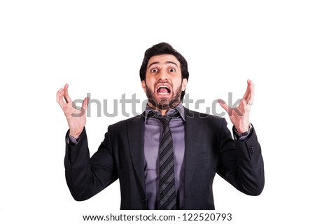 angry businessman screaming with his arms raised