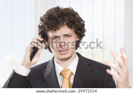 Angry businessmen explains in the phone