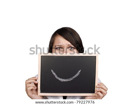 Angry businesswoman behind smiley face