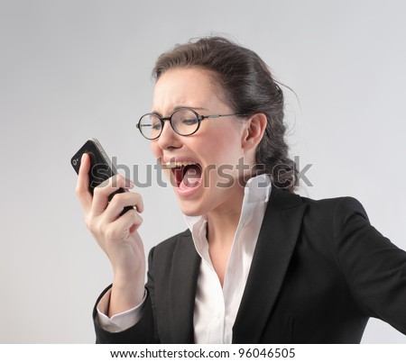 Angry businesswoman screaming on the mobile phone