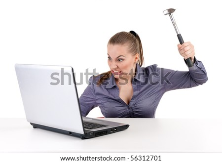 angry businesswoman went mad with hammer and laptop