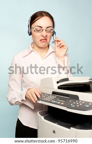 Angry businesswoman with copier thinking on the  background