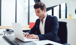 Angry caucasian businessman in formal wear furious about problems browsing web page on laptop computer having trouble with connections,crazy male entrepreneur feeling rage about failure with banking