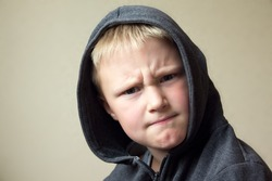 Angry child (boy, kid) portrait