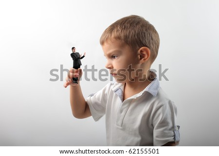 Angry child holding a scared businessman