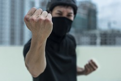 Angry Chinese gang member fighting on the street.