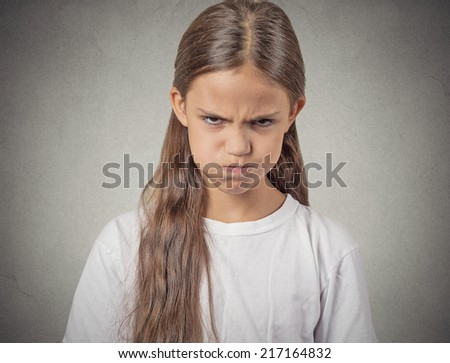 Angry. Closeup portrait young girl having nervous breakdown isolated grey wall background. Negative human emotions facial expressions feelings, bad attitude, body language, reaction, life perception