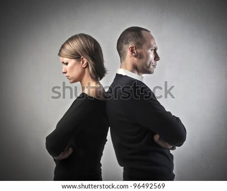 Angry couple turning their back on each other - stock photo