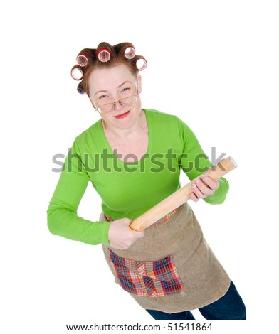 Angry crazy  housewife in hair rollers is holding.Angry look on face. Studio, white background.